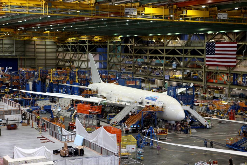 An aircraft on an assembly line